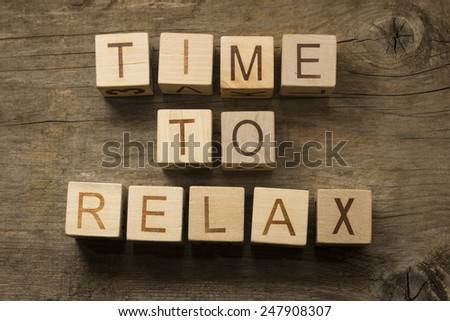 Time To Relax text on a wooden cubes - stock photo
