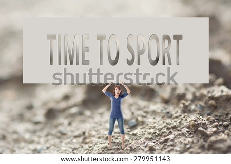 Time to sport, words on blank board hold by a young girl in the outdoor. - stock photo