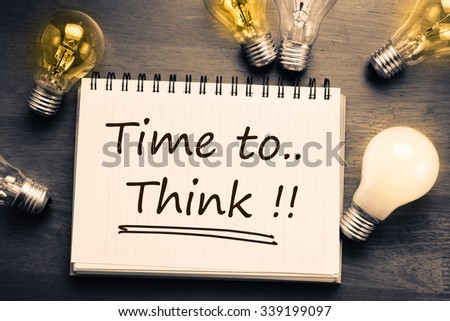 Time To Think, handwriting on notebook with light bulbs - stock photo