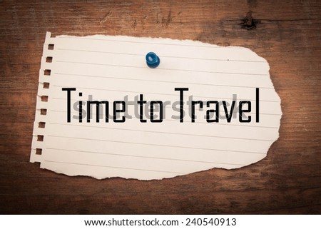 Time to travel text on paper torn and wood  - stock photo
