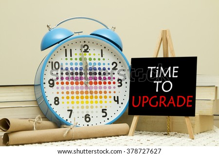 Time to upgrade message written on a small blackboard. - stock photo