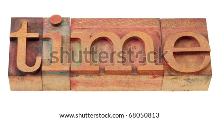 time - word in vintage wooden letterpress printing blocks, stained by color inks, isolated on white - stock photo