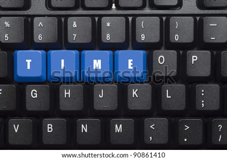 time word on blue and black keyboard button - stock photo