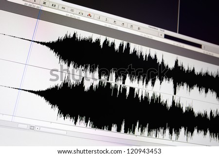 Timeline window with black sound waveform in the film editing soft. - stock photo