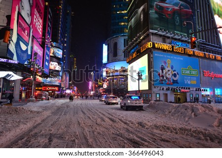 Times sq new york snow/ snow new york/ New York, USA - January 23, 2016: Times square new york in snow during a blizzard with people, police cars and no traffic and advertisement  - stock photo