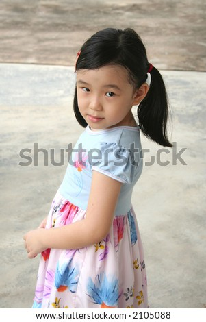Timid girl with shy face expression standing alone - stock photo