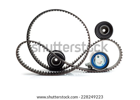Timing belt, two rollers and the tension mechanism. Isolate. - stock photo