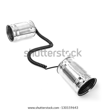 Tin can phones on white background - stock photo