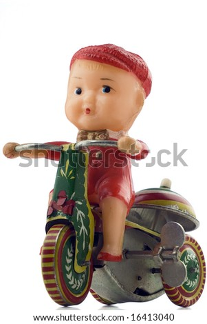 tin windup toy - boy riding bicycle - stock photo