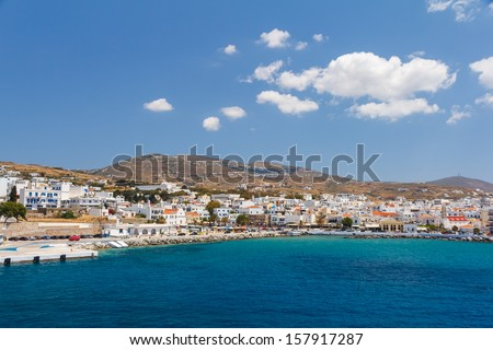 Tinos city and harbor in Cyclades against a blue sky, Greece - stock photo