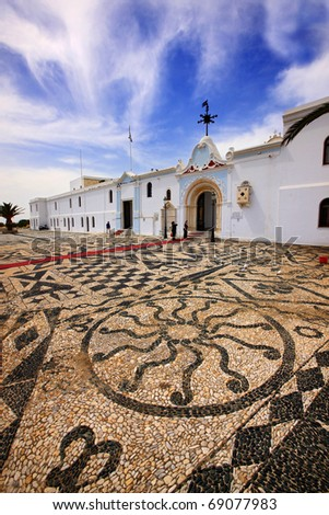 Tinos island, Greece. Traditional, impressive mosaic made of sea pebbles, outside the church of Virgin Mary, where on of the most important pilgrimages for Greek-Orthodox takes place in August 15. - stock photo