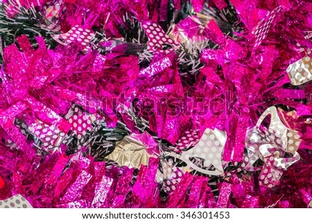 Tinsel background for festival season - stock photo