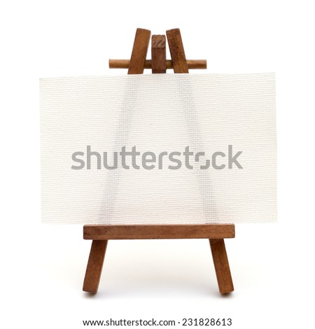 Tiny canvas on easel isolated on white background - stock photo