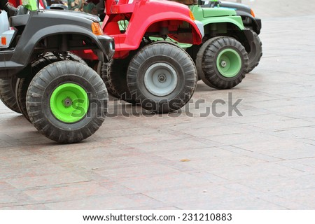 Tiny children's cars for entertainment in the park - stock photo