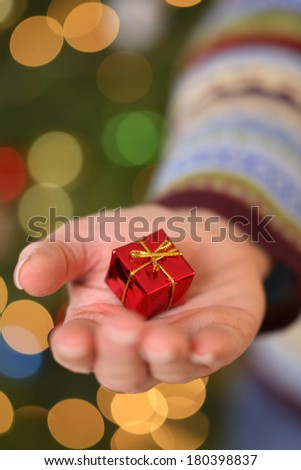 Tiny Christmas Present in Hand - stock photo