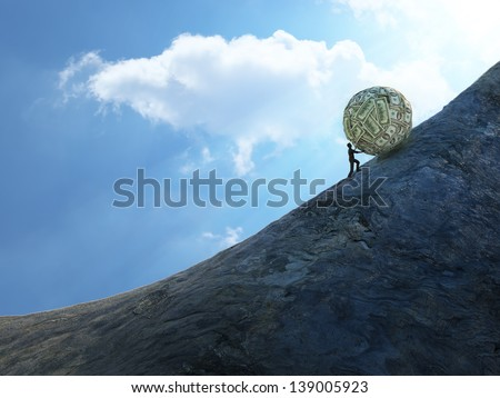 Tiny man pushing a huge ball of money up hill - stock photo