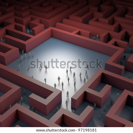 Tiny people lost in a maze - stock photo