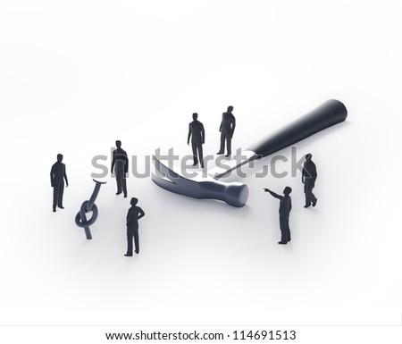 Tiny people trying to hammer a nail - problem solving concept - stock photo