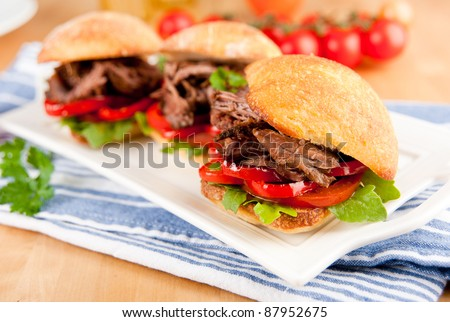 Tiny Slider Sandwiches with Pulled Beef and Red Bell Peppers - stock photo