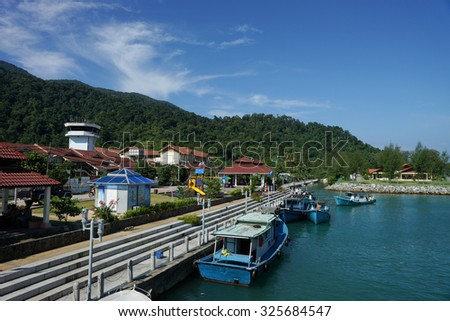 TIOMAN, MALAYSIA - 28TH MAY 2013; A view of jetty with boats at Tioman island on 28th May 2013. - stock photo