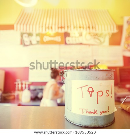 Tip jar in a colorful ice cream shop, instagram style filter  - stock photo
