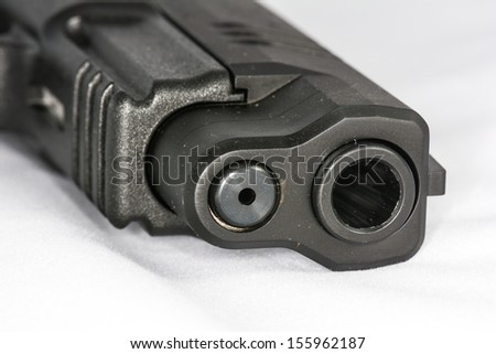 Tip of a hand gun isolated with white background - stock photo