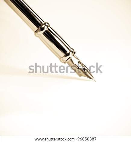 Tip of the fountain pen on white paper - stock photo