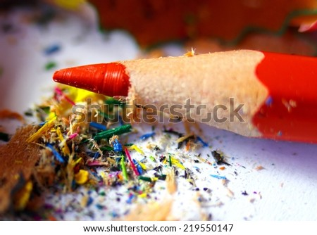 Tip of the red pencil with the remains of the pencils to school - stock photo