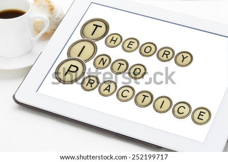TIP (theory into practice) acronym explained with old typewriter keys on a digital tablet with a cup of coffee - stock photo