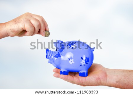 Tip throw in piggy bank - stock photo