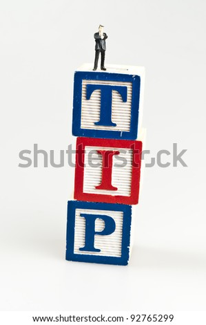 Tip word and toy business man - stock photo