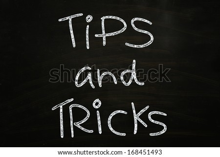 Tips and Tricks Lettering, written with Chalk on Blackboard - stock photo