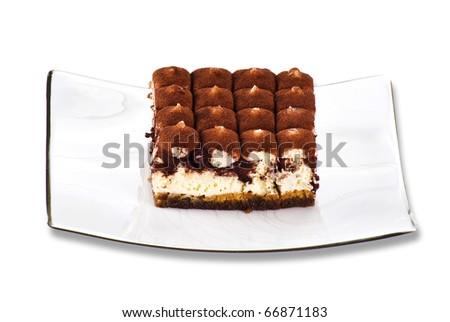 Tiramisu cake on the plate over white background - stock photo