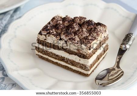 Tiramisu cake served on a plate - stock photo