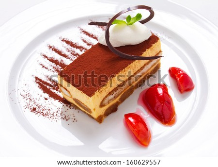 Tiramisu is a coffee flavored Italian dessert. It is made of ladyfingers dipped in coffee, layered with a whipped mixture of egg yolks, egg whites, sugar and mascarpone cheese, flavoured with cocoa. - stock photo
