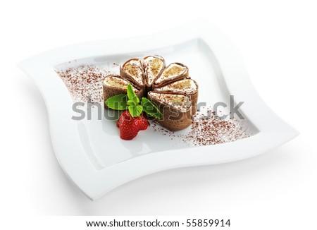 Tiramisu Sushi Roll garnished with Strawberry and Mint - stock photo