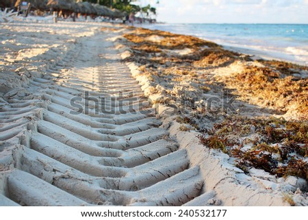 Tire imprint on the sand - stock photo