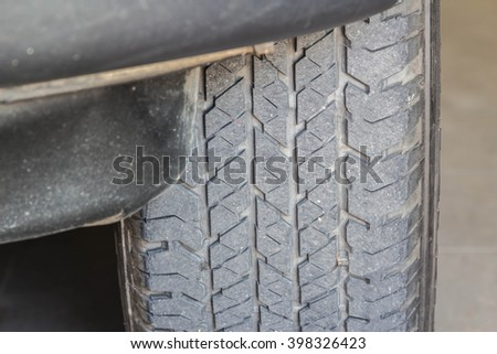 tire in use with dust - stock photo