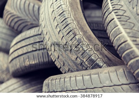 tire, maintenance, service and motor transport concept - close up of wheel tyres - stock photo