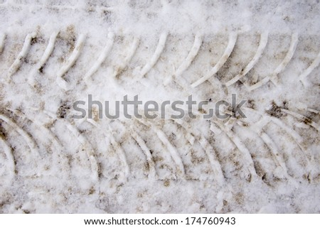 Tire track in snow - stock photo