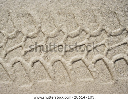 Tire track on the sand. - stock photo