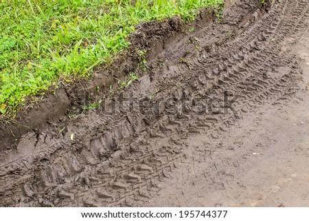 Tire tracks adventure on Dirt Road - stock photo