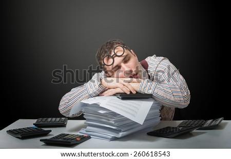 Tired accountant, humorous portrait - stock photo