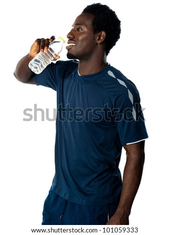 Tired african athlete drinking water against white background - stock photo