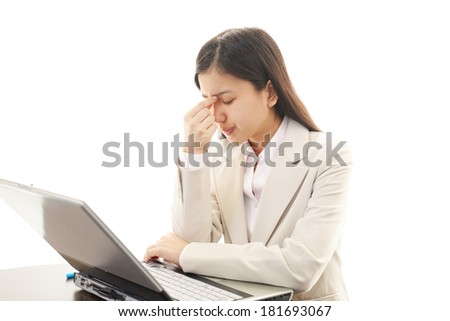 Tired and stressed young Asian woman - stock photo