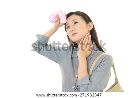 Tired and stressed young woman - stock photo