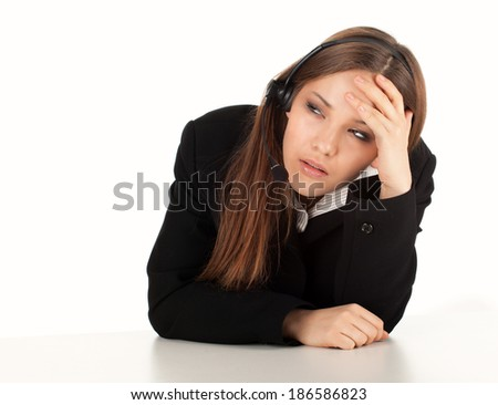 tired assistant with headphones, white background - stock photo