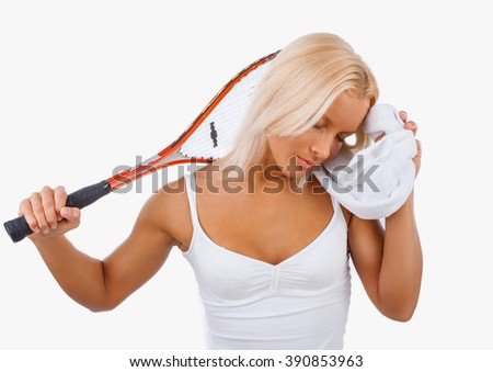 Tired blond female in a white dress after tennis game. - stock photo