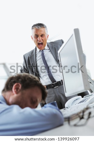 Tired business man sleeping at work. In the background is angry boss shouting - stock photo