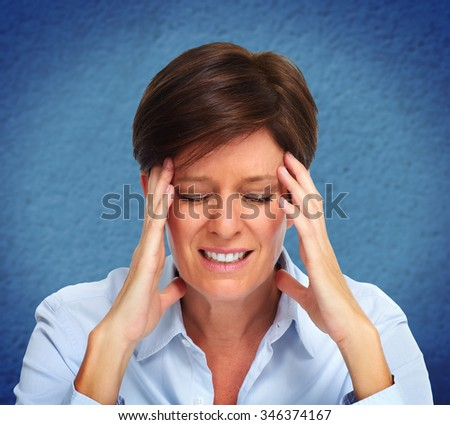 Tired business woman with headache migraine. Stress and health problems. - stock photo